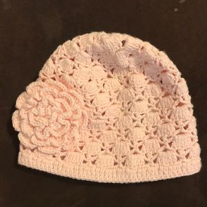 Pink crochet hat with flower